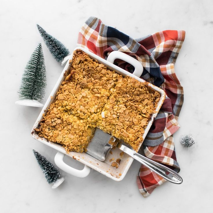 Christmas Morning Wife Saver is a Canadian classic dish with peameal bacon and melty Canadian cheese layered between bread and soaked overnight in milk and eggs. We slightly altered the original recipe, created by Best of Bridge, adding jalapeños for additional spice and topped the casserole with honey cereal flakes to provide a sweet crunch. #BeautifulFood #ChristmasRecipes #Strada #BrunchRecipes