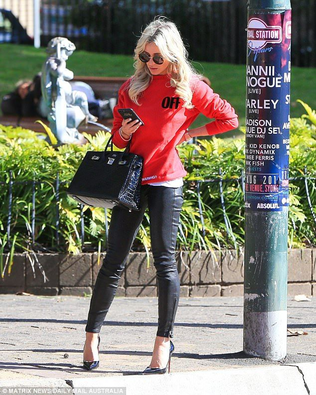 Hurry up!The platinum blonde publicist was also seen looking at her personalised iPhone, featuring the names of her children - Pixie, five and Hunter, three