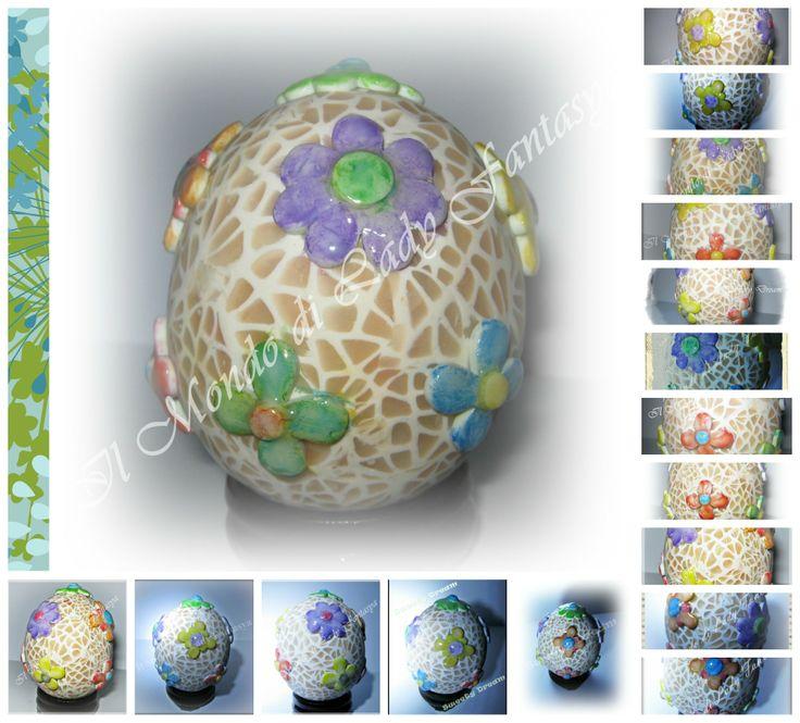Guscio di gallina ricoperto da due strati di paste polimeriche,il secondo con motivo a rete,decorato poi da fiori sempre in paste polimeriche colorati con acquerelli