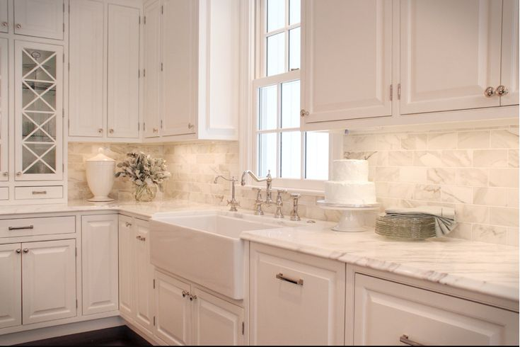 Super white granite counter top carrera marble backsplash for Best countertops for white kitchen cabinets