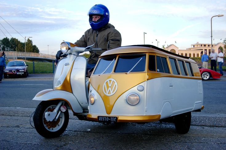 That VW bus is driving a little too close to that giant on the motorcycle