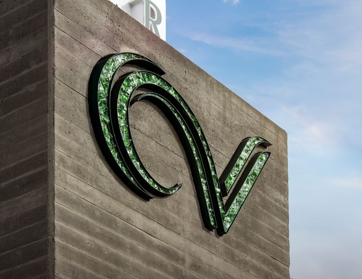 The CV channel letter logo was fabricated from aluminum and cast into the board formed concrete. The logo is illuminated using glass rock and resin.