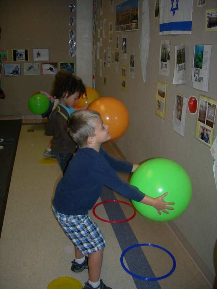 Learning to bounce and catch. Facing the wall helps to control the ball. Bounce into a small hoop for a target.