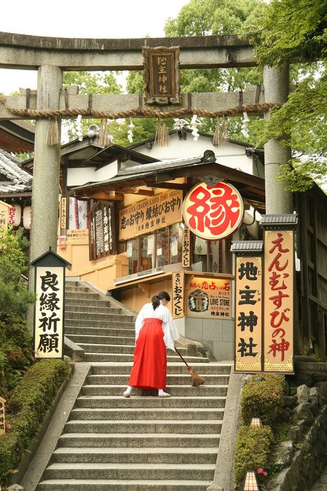Mikosan( Miko maiden cleaning the steps of shrine) Japan