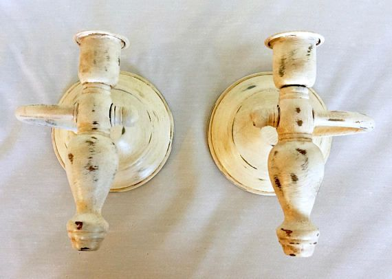 Charming Farmhouse Candleholders. Included in the listing are two updated candleholders. They may be wall mounted or placed on a surface! The candleholders are movable on their base. These two wood and brass candleholders from the 70s have been refinished in several coats of