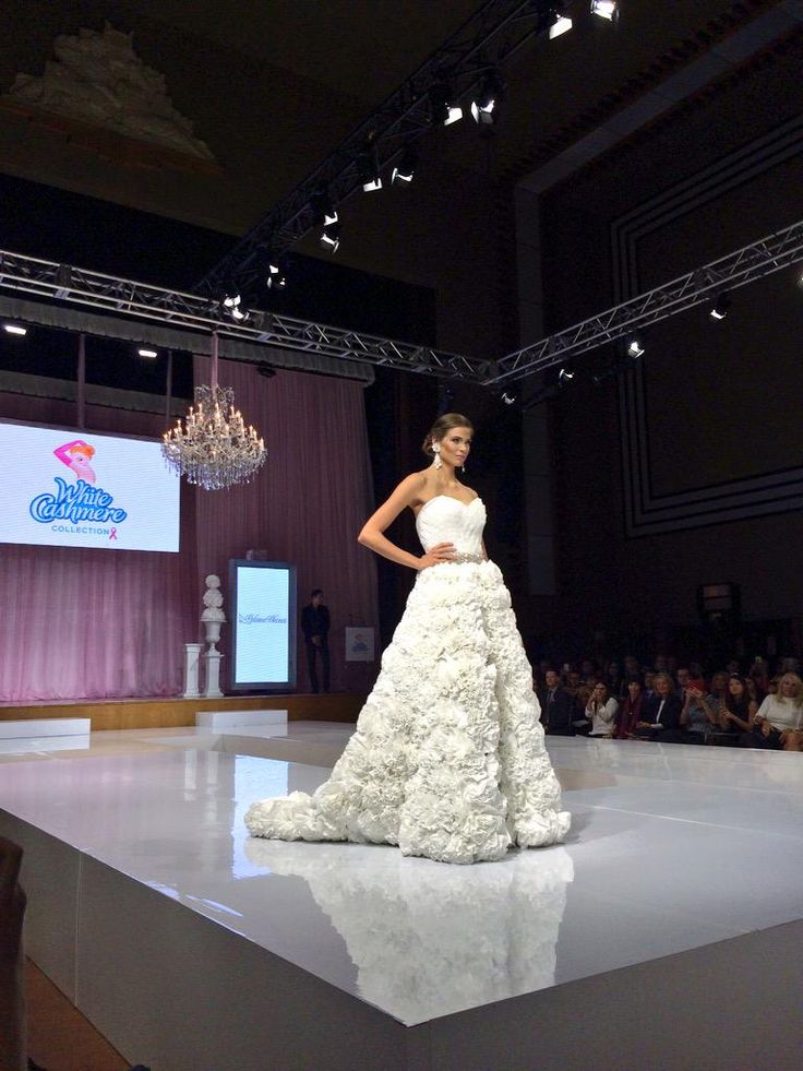 Let's talk about the stunning rosette-adorned skirt on this @Paloma_Blanca gown! #Cashmere15