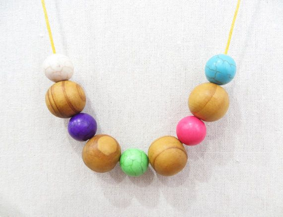 Hey, I found this really awesome Etsy listing at https://www.etsy.com/listing/185056634/natural-wooden-and-howlite-necklace