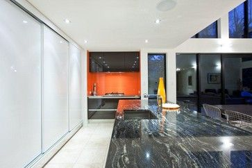 Orange, Black and White Kitchen - modern - kitchen - other metro - Natalie Du Bois. Cosmic black granite.