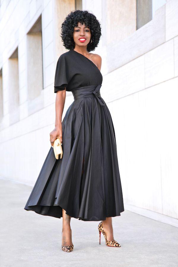 Off-shoulder charcoal bell-sleeve A-line dress w/ golden hardshell clutch