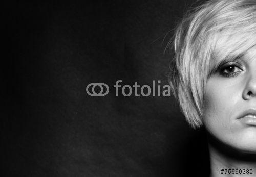 """Pobierz zdjęcie royalty free  """"Blonde girl with a short stylish haircut on a dark background"""" autorstwa shadow7777 w najniższej cenie na Fotolia.com. Przeglądaj naszą bazę tanich obrazów online i odnajdź doskonałe zdjęcie stockowe do Twoich projektów reklamowych!"""