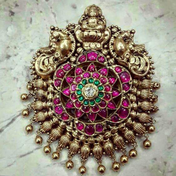 Lakshmi and Peacocks carved Antique Ruby Pendant www.addiga.com