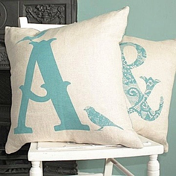 "Personalised Alphabet Linen Cushion. Available in slate grey or duck egg blue, you can choose any letter of the alphabet or a lace print ampersand. Feather cushion pad and zip fastening. 17"" square. £75"