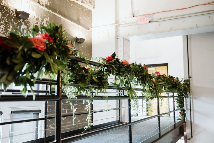 Susan Foy's florals dress up Rhinegeist's Annex Bridge beautifully! Photo by: Eleven:11 Photography.