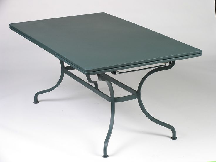 """Fermob Romane Table 118x39 The Romane Table is 118"""" x 39"""" when its extensions are open and 79 x 39"""" when closed. Can fit between ten to fourteen guests. Its base is solid steel and has a flat steel belt. The table top is solid steel sheet and has rounded corners. The cataphoresis finish, a high protection treatment makes it great table for outdoor use."""