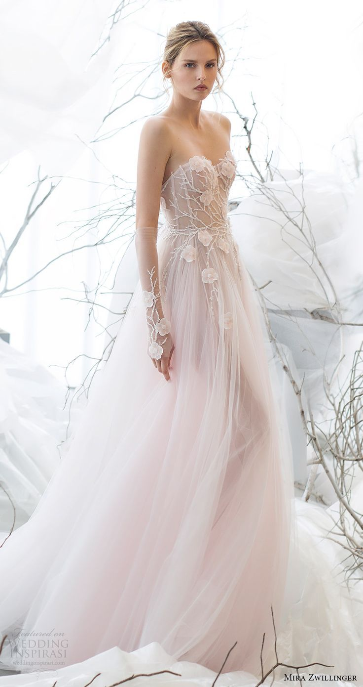 Beautiful strapless light pink wedding dress.