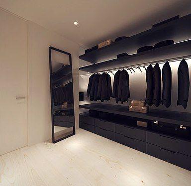 Clean black closet with illuminated hanging rods.