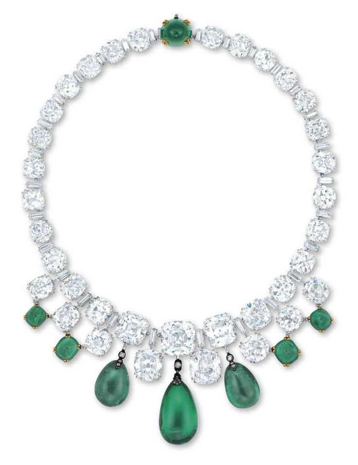 AN EXCEPTIONAL EMERALD AND DIAMOND NECKLACE Designed as a line of graduated old European and cushion-shaped diamonds alternating with baguette-cut diamonds, the front suspending a fringe of emerald drops, flanked by cabochon emeralds, accented by a sugarloaf emerald clasp, mounted in platinum and 18k yellow gold