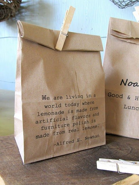 Get a set of alphabet stamps and stamp each name on a paper bag? little pegs are easy to find