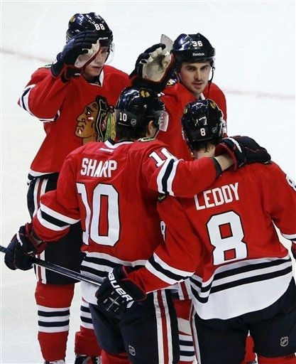Chicago Blackhawks defenseman Nick Leddy (8) celebrates his goal with Patrick Kane (88), Dave Bolland (36), and Patrick Sharp during the second period of an NHL hockey game against the Anaheim Ducks, Tuesday, Feb. 12, 2013, in Chicago. (AP Photo/Charlie Arbogast)