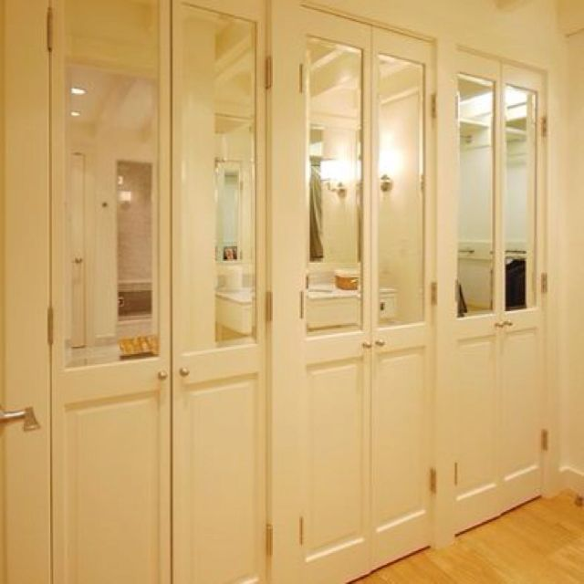 Half mirrored French doors. Closets ...