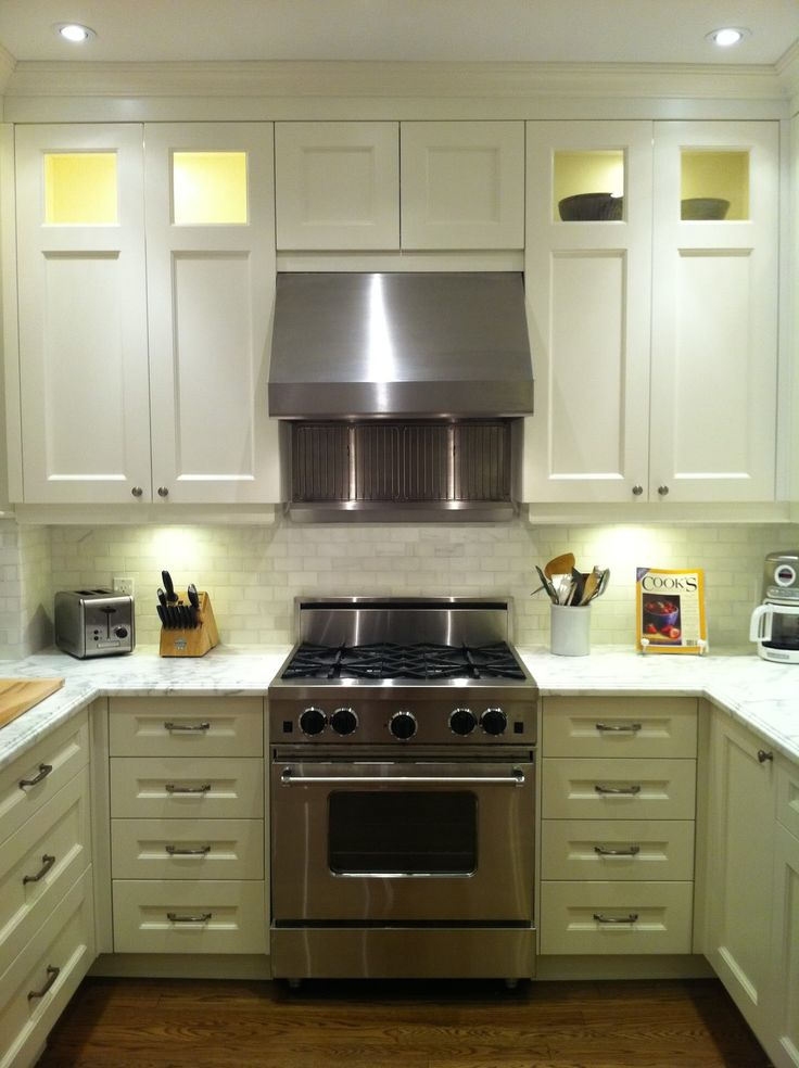 kitchen cabinets lighting. kitchen lighting above cabinet with stainless steel range hood vent also wooden knife block holder aside 2 slice electric toasters cabinets