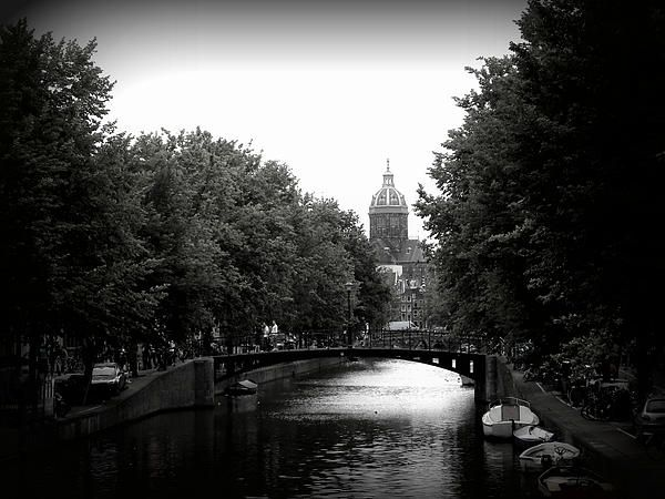 This is a photo taken from a bridge over a canal in Amsterdam.