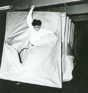 Murakami Saburo hurling himself through 40 screens of paper in 1955. He called it Laceration of Paper.