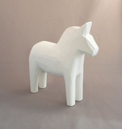 white dala horse waiting to be decorated.