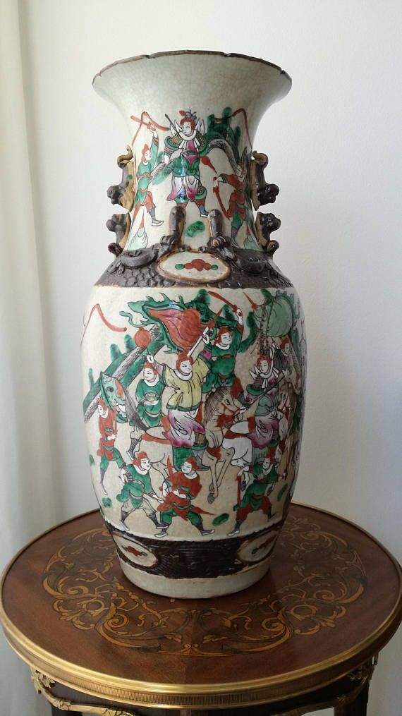 Check out this item in my Etsy shop https://www.etsy.com/listing/564526781/antique-chinese-vase-crackleware-vase