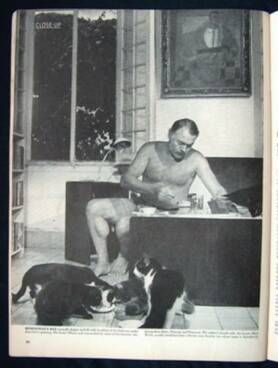 Ernest Hemingway and his fabled six-toed companions.