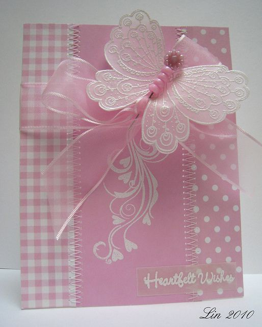 Vellum butterfly ..all in pink with different patterned papers...
