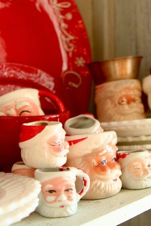 Vintage Santa mugs. I still have the mug given to me by my first grade teacher MANY,MANY years ago.