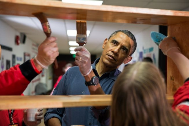President Obama stains shelves during a National Day of Service school improvement project at Burrville Elementary School in Washington,D.C.,Saturday,1/19/2013.The First Family kicked off events for the 57th Presidential Inauguration by joining in the National Day of Service.