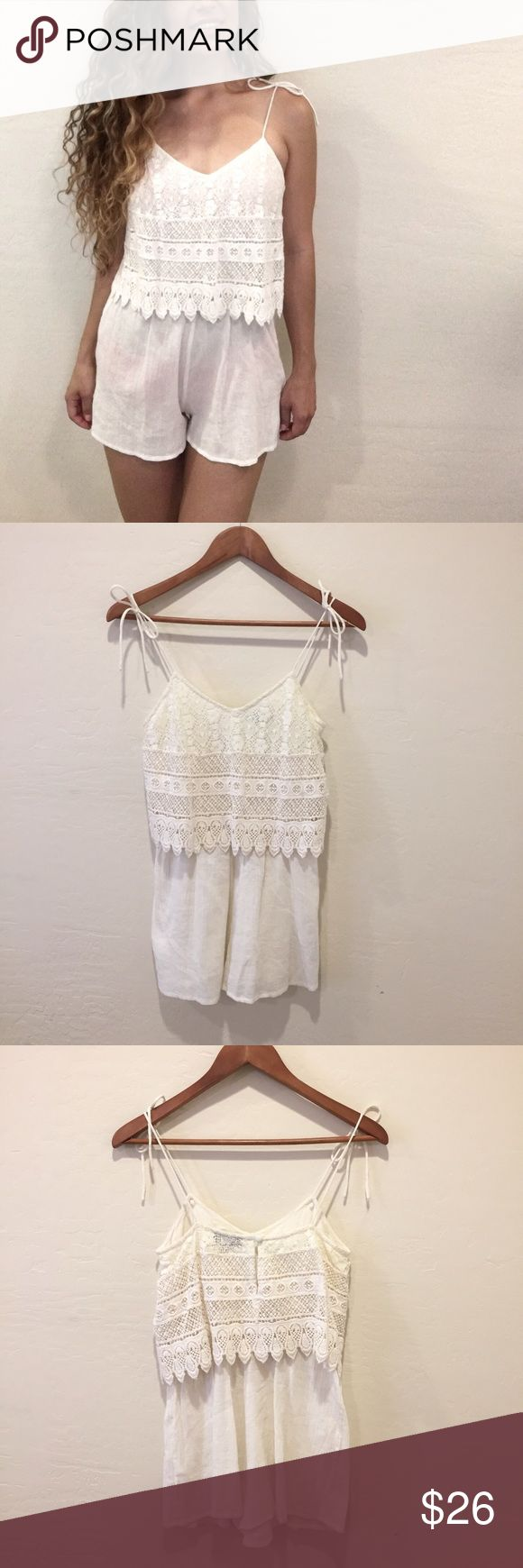 "Topshop Crochet Layer Playsuit Topshop Crochet Layer Playsuit! Women's size 4. In like-new condition. Catch the sun in this soft cream playsuit! Perfect as a swimsuit coverup! Transparent material. Shoulder ties. Lace design. Button closure in back. Perfect for complimenting sun-kissed skin! Approximate measurements given below:  Length: 29"" Inseam: 2"" Material: 100% cotton Size: 4  🔸10% off bundles of 2 or more items 🔸No Trades 🔸Reasonable offers accepted 🔸Fast Shipping  Please comment…"