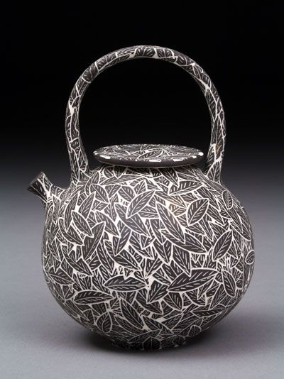 Becky and Steve Llyod - teapot.  Functional, but I doubt I'd ever use these delicate works of straffigio scribed art.