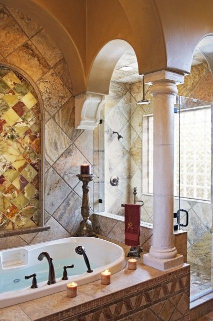 Mediterranean Style Bathroom With Columns, A Mix Of Marble And Onyx, And A  Glassed