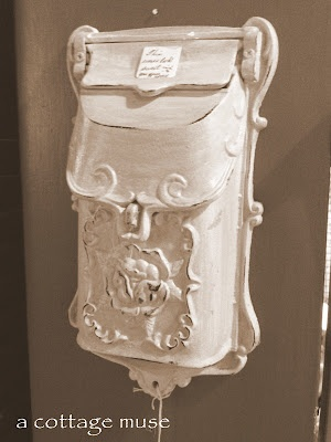 <3  I have a similar antique mailbox. Haven't exactly decided how & where I will use it. There are so many Fab Ideas!!