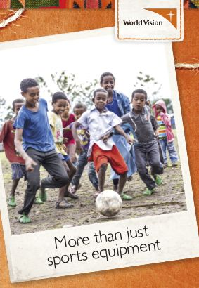 A soccer ball means fun for all as children gather for a lively game of football in Ethiopia.