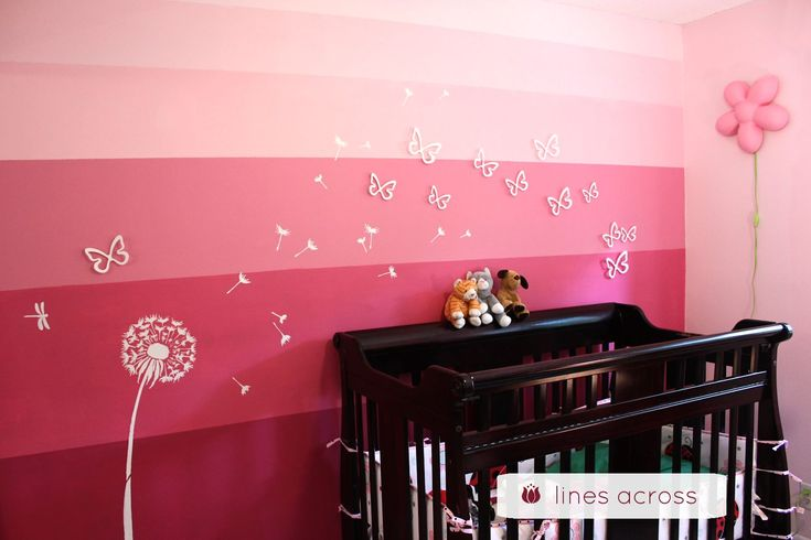 Pink ombre wall.  I actually REALLY like how she varied the widths of the stripes--much more interesting than doing the stripes all the same width apart (to me, anyway).  Also like the dandelion stencil and butterflies!