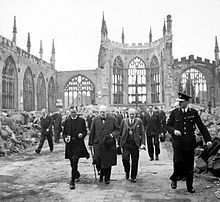 "Winston Churchill walks through the ruins of Coventry Cathedral, 1941. Churchill's speeches were a great inspiration to the embattled British. His first speech as prime minister was the famous ""I have nothing to offer but blood, toil, tears, and sweat"". One historian has called its effect on Parliament as ""electrifying""; the House of Commons that had ignored him during the 1930s ""was now listening, and cheering""."