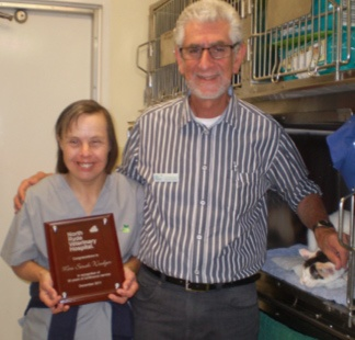 Our terrific thirty...Dr George gives sarah her award for 30 years of continuous service at North Ryde Vet Hospital. But there's so much more to her story. Read it here.