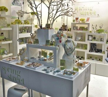 Booth Display Ideas, I really like the branch The color balance draws attention to the area also to draw in customers