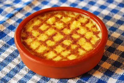 Arroz Doce (Portuguese Sweet Rice):   2 cups water,      1 cup white rice,      2 cups hot milk (whole works best),      1 cup sugar,      1 fresh lemon rind (use a vegetable peeler for big pieces for easier removal), cinnamon  #Portugal