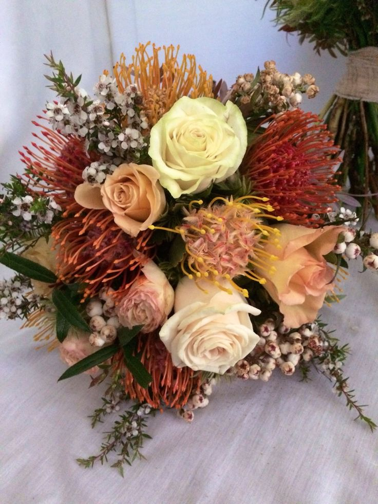 Apricot mix of natives and roses.