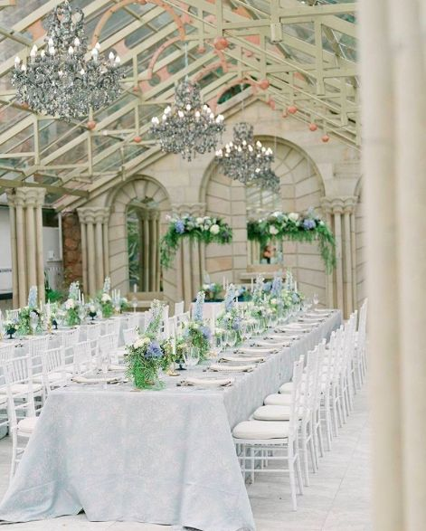 For this enchanted wedding, the white of the decor, beige of the venue, & hints of green in the florals create a beautiful flow #EventProfs