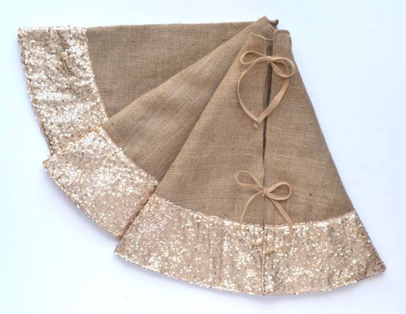This classic and elegant tree skirt is crafted with natural burlap and trimmed with champagne taffeta sequins. It is a perfect match to our burlap