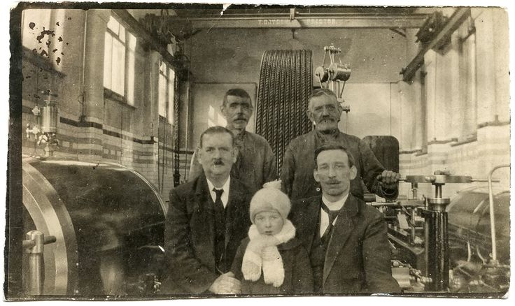 Vintage photograph of four men and a child at T. Dryden's Iron Foundry in Preston, Lancashire.
