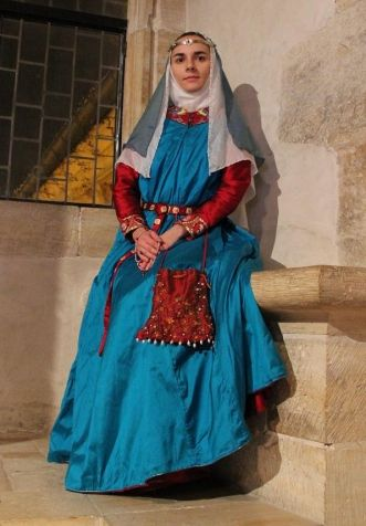 14th century noble clothing    Clothing of Noble lady at the beginning of 14th century in Western Europe. It consist of red silk cotte and blue silk surcotte. The surcotte is lined by woolen fabric. The neck-opening and sleeve edges are decorated by embroidery which can be seen in next pages. Important part of entire outfit is also silk purse with embroidery and the belt.