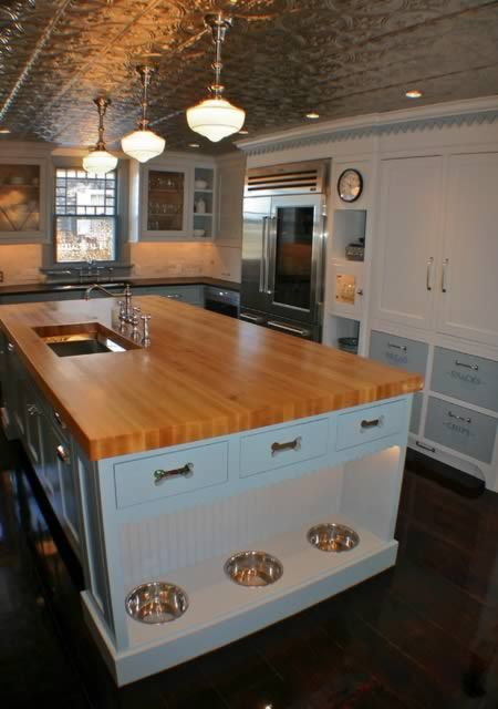 Artisan Kitchens is designing kitchen furniture with built-in feeding stations to keep things tidy. @ 10 Awesomely Clever Pet Friendly Furniture Items - Oddee.com