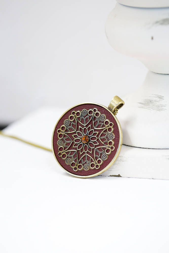Burgundy Leather Bronze Silver Pendant / Bronze Color Chain by BeautyfromashesUSA on Etsy https://www.etsy.com/listing/577508565/burgundy-leather-bronze-silver-pendant